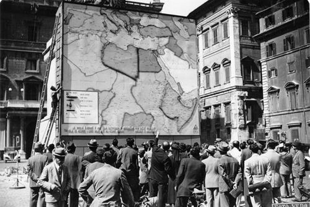 1941_italians_in_front_of_a_giant_map_of_north-eastern_africa_the_italian_empire_territories_are_in_high_relief_rome.jpg