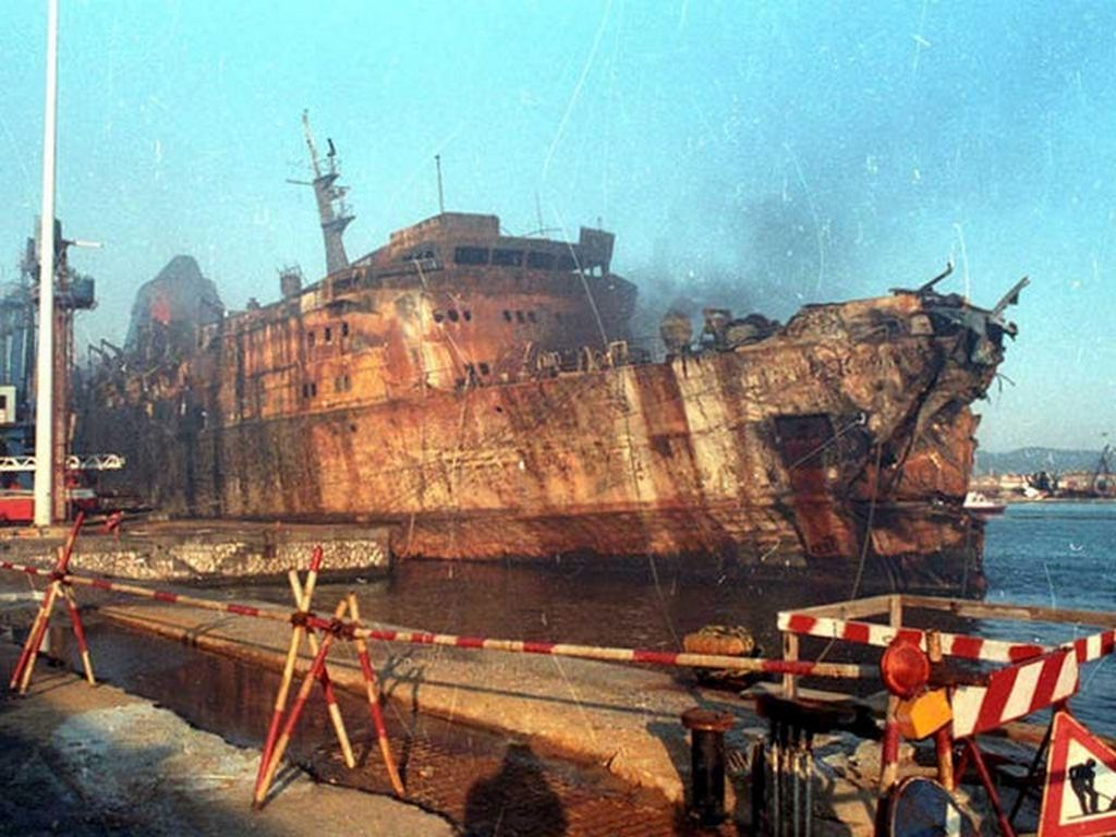 1991_the_burned_italian_ferry_moby_prince_is_towed_into_port_after_her_fatal_collision_with_the_oil_tanker_agip_abruzzo_140_killed_with_one_survivor.jpg