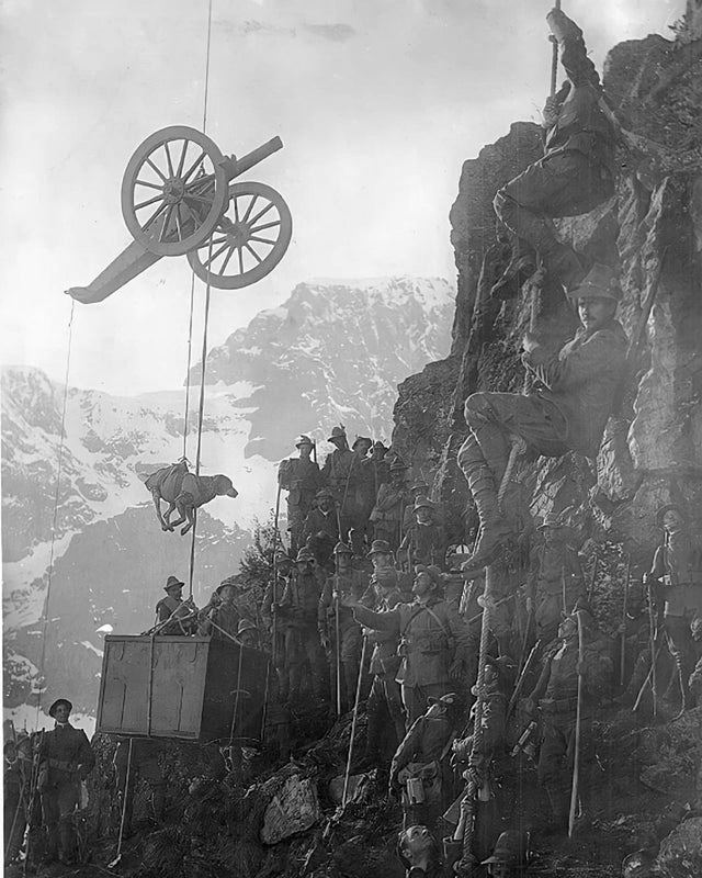 1915_italian_soldiers_hoisting_a_crate_dog_and_artillery_gun_up_a_mountain.jpg