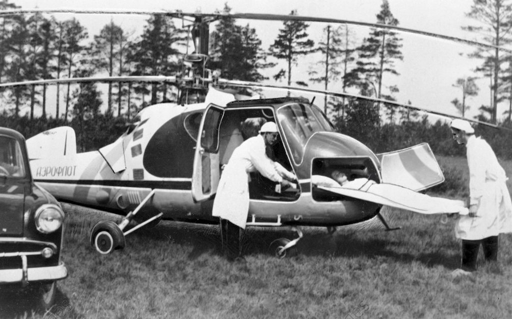 1972_ambulancemen_putting_a_litter_with_an_accident_victim_into_a_ka_18_hog_helicopter.jpg