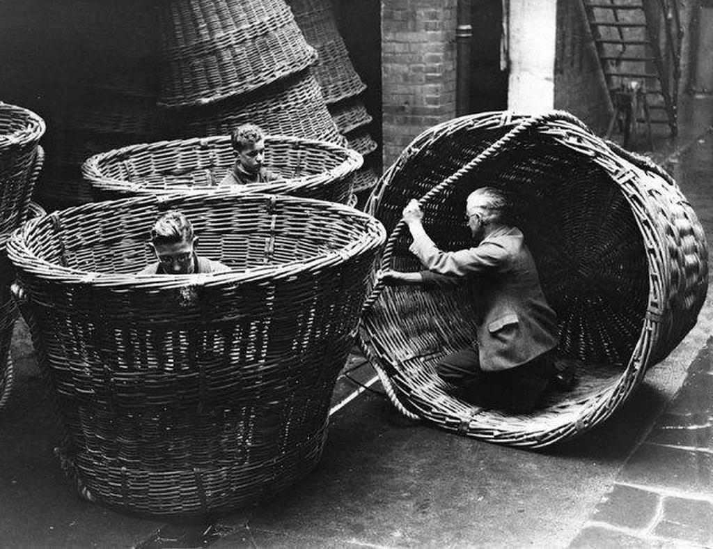 1938_men_at_work_at_the_cardiff_institute_making_huge_baskets_unique_in_size_and_construction_for_loading_oil_cake_in_south_africa1.jpg