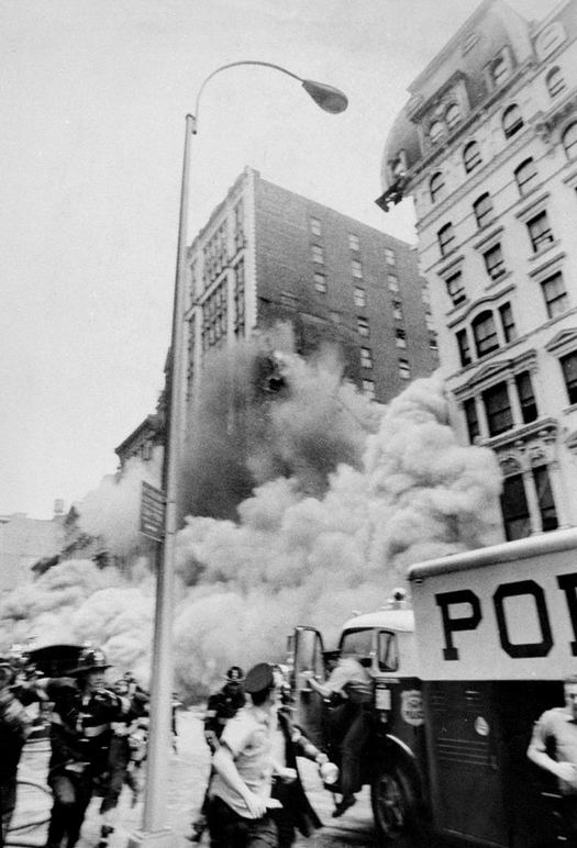 1973_augusztus_emergency_service_workers_run_for_cover_as_a_section_of_the_university_hotel_formerly_the_broadway_central_hotel_collapses.jpg