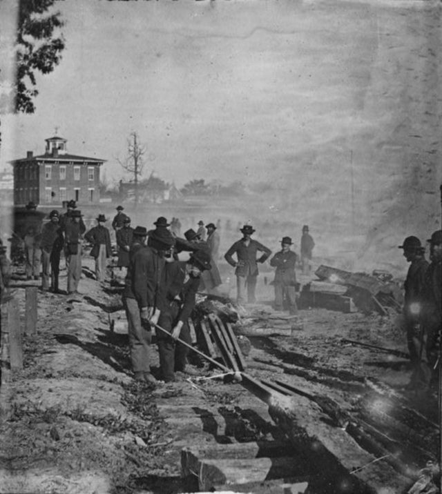 1864_union_soldiers_under_general_william_t_sherman_destroys_railroads_in_atlanta_georgia_to_deprive_the_confederate_army_of_supplies_and_communications_during_sherman_s_march_to_the_sea_c_november.jpg