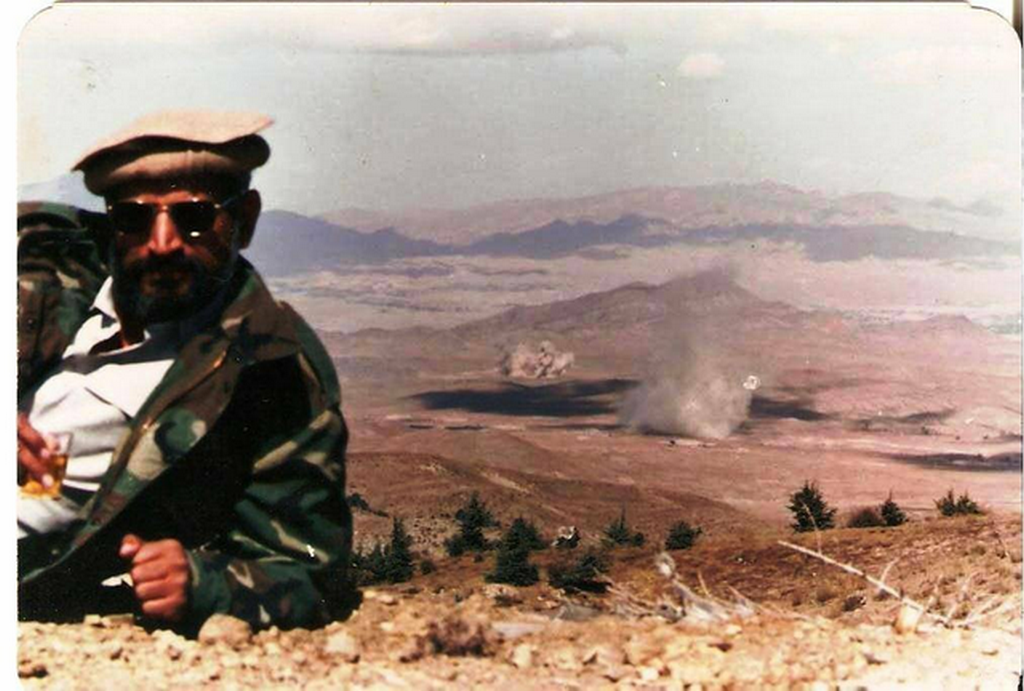1985_korul_brigader_yasub_dogar_of_the_pakistani_isi_enjoying_a_drink_while_soviet_supply_depots_are_destroyed_in_the_background_soviet-afghan_war_gardez.png