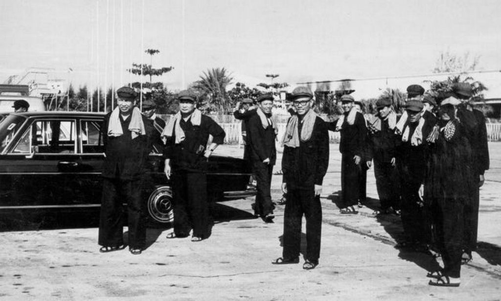 1975_pol_pot_front_left_and_khmer_rouge_leaders_stand_by_a_mercedes_benz_600_in_cambodia.jpg