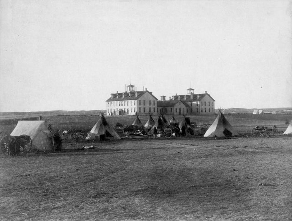 1891_native_american_parents_camping_outside_indian_boarding_schools_where_their_children_were_possibly_taken_by_force_pine_ridge_south_dakota.jpg