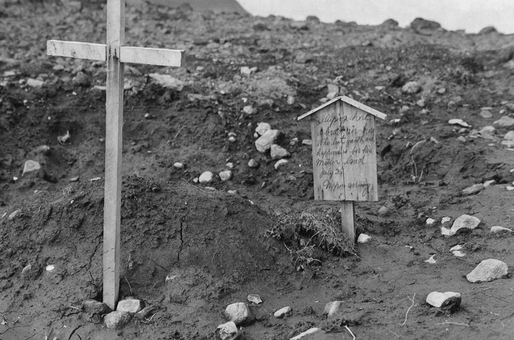 1943_grave_of_american_pilot_buried_by_japanese_troops_the_sign_reads_sleeping_here_a_brave_air-hero_who_lost_youth_and_happiness_for_his_mother_land_nippon_army_kiska_alaska.jpg