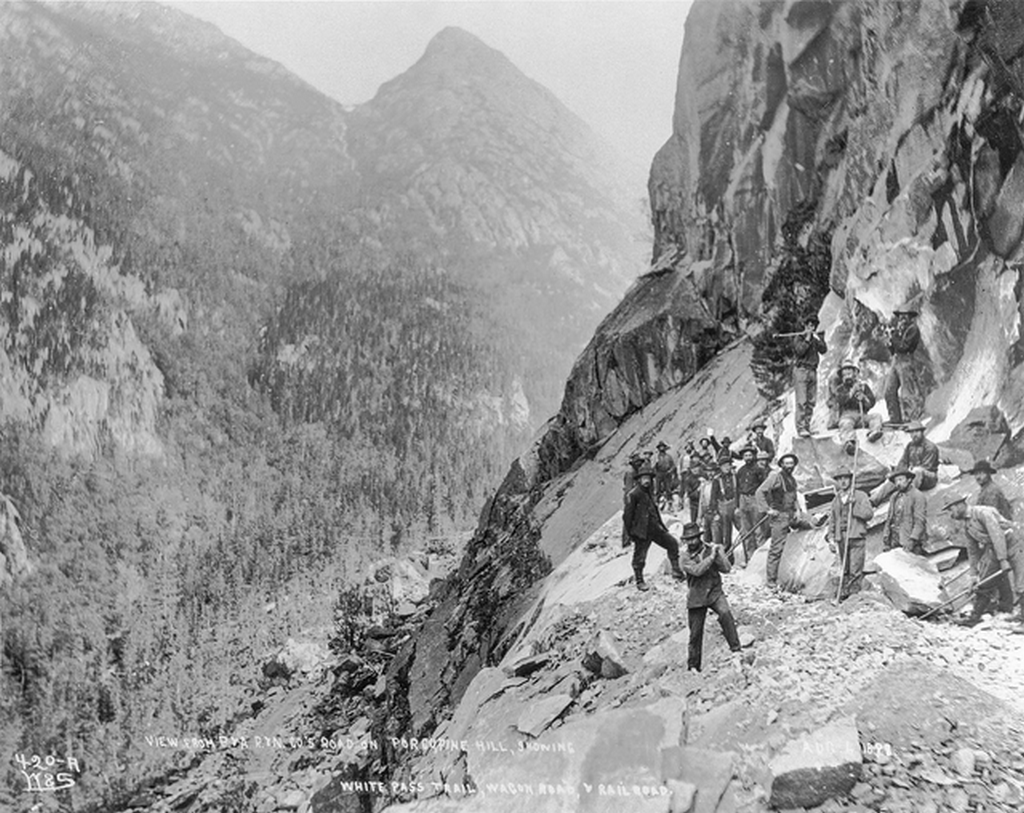 1898_building_of_the_railway_through_the_white_pass_trail_british_columbia.png