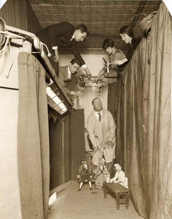 1927_puppet_master_tony_sarg_rehearsing_on_his_marionette_stage.jpg