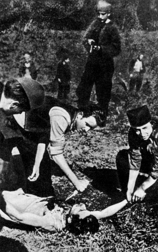 1943_korul_chetniks_in_umadija_yugoslavia_kill_a_partisan_through_heart_extraction.jpg