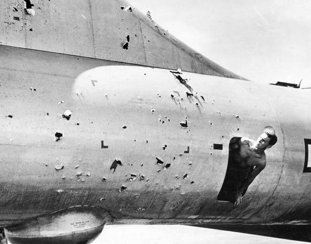 1945_aprilis_a_crew-member_inspects_the_flak_damage_to_his_b29_after_a_raid_on_tokyo.jpg