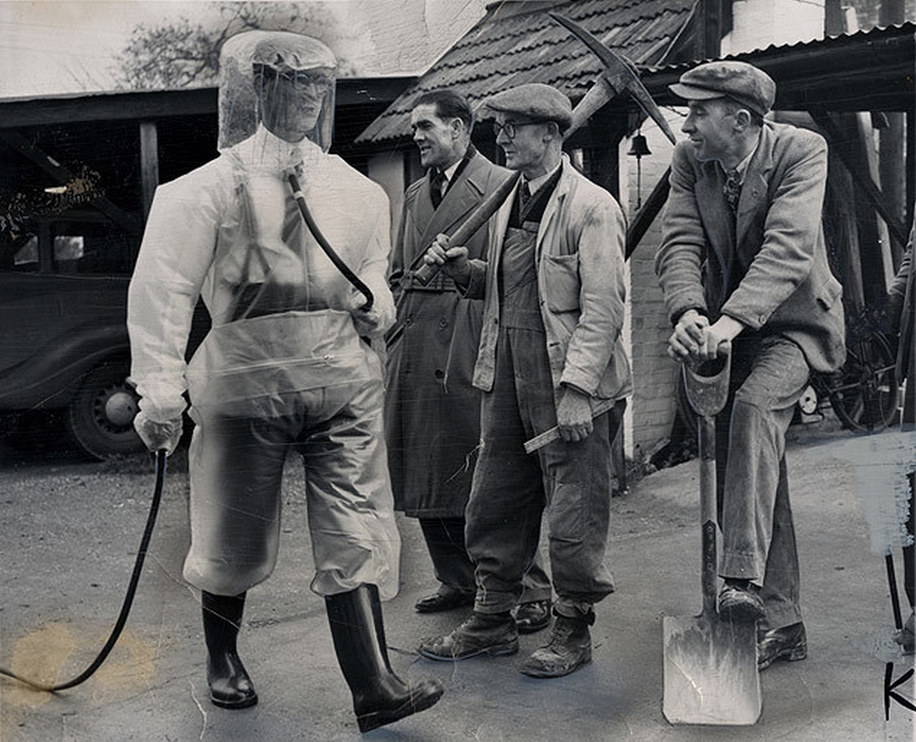 1954_an_atomic_factory_worker_wearing_a_plastic_suit_walks_past_his_more_traditionally_dressed_peers_britain.png