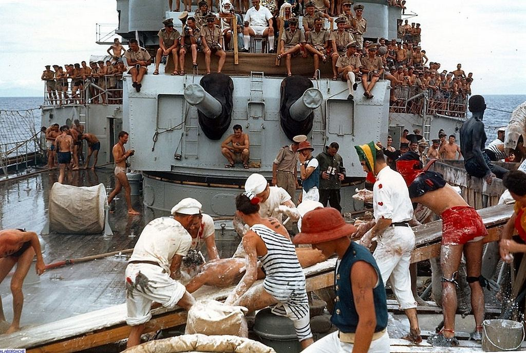1964_crew_aboard_french_cruiser_jeanne_d_arc_have_fun_with_a_soap_board_during_a_passage_of_the_line_activity.jpg