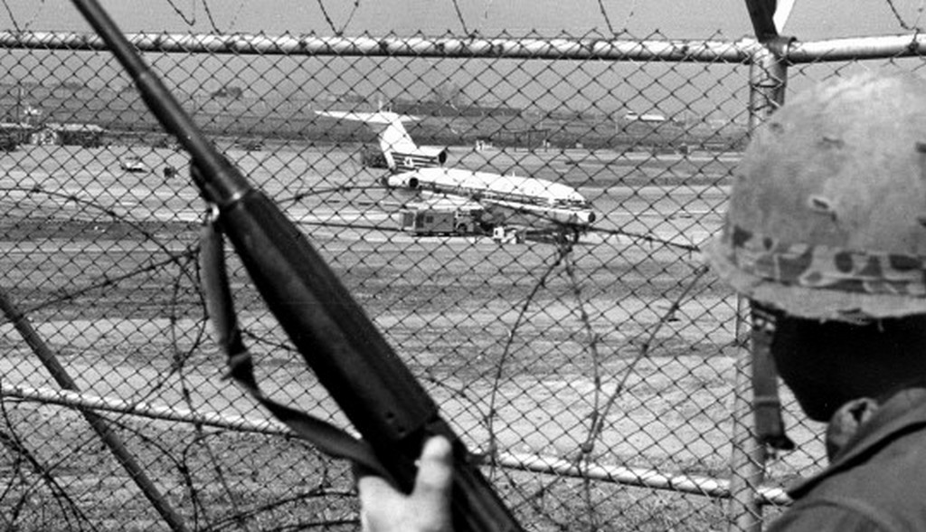 1970_south_korean_soldier_keeps_an_eye_on_japan_airlines_flight_351_which_was_hijacked_by_nine_members_of_the_japanese_red_army_faction_and_heading_for_north_korea.jpg