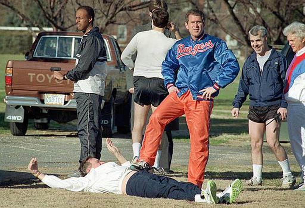 1990_george_bush_jr_and_his_father_president_george_bush_as_the_president_attempts_to_stretch_prior_to_jogging_at_fort_mcnair.jpg