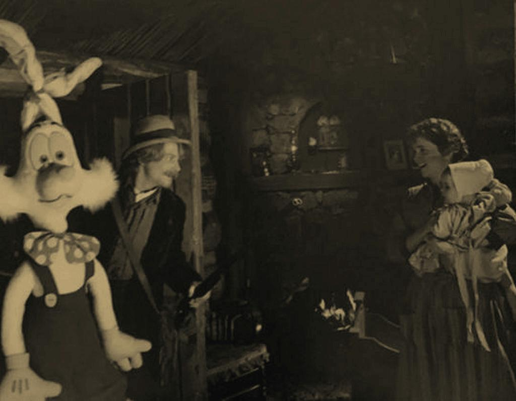 1885_a_father_brings_home_today_s_hunt_along_with_hope_that_they_may_survive_the_coming_winter.jpg