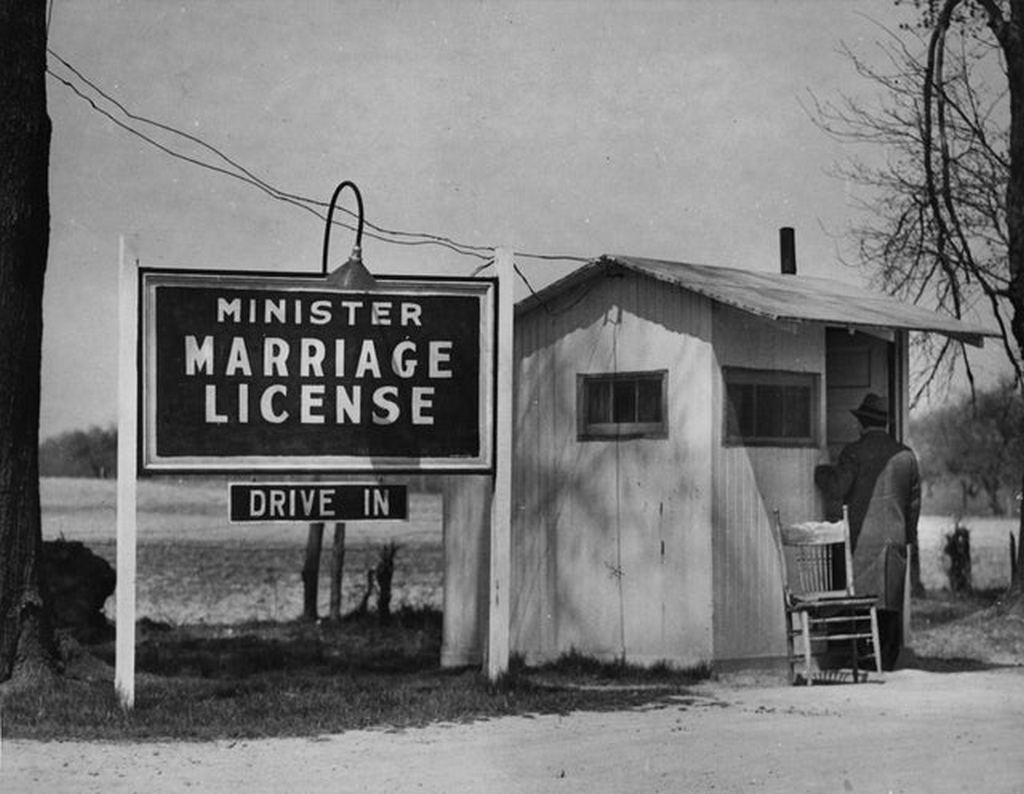 1930_a_walk-up_customer_at_the_door_of_a_minister_s_marriage_license_booth_in_elkton_maryland.jpg