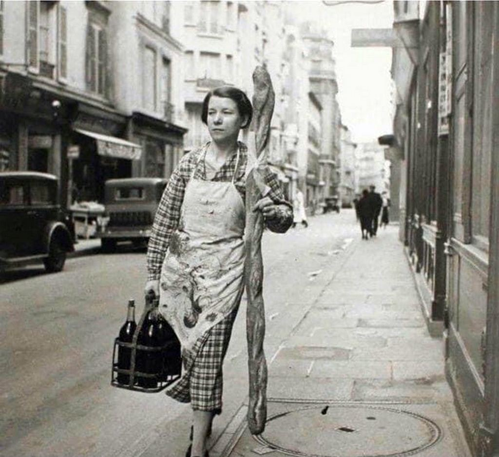 1945_a_french_woman_with_her_baguette_and_six_bottles_of_wine_paris_france.jpg