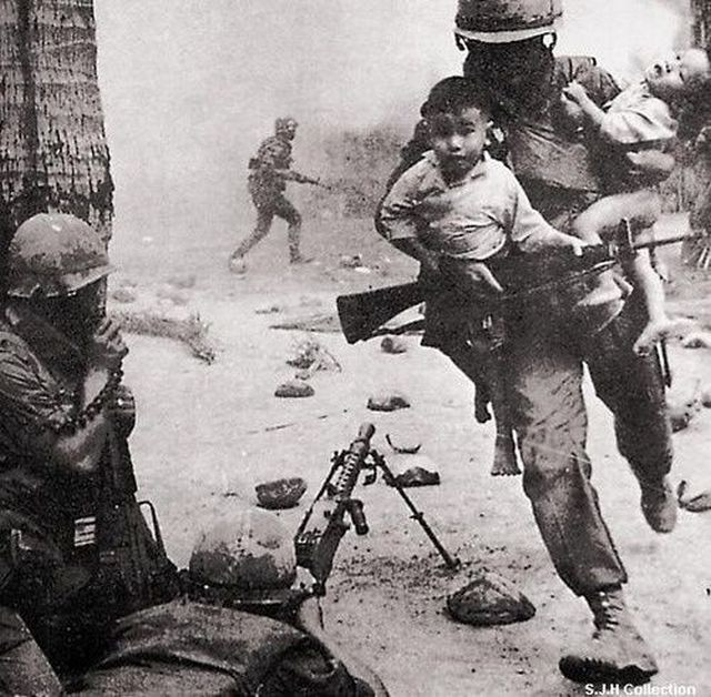 1968_a_u_s_marine_rescues_two_vietnamese_children_during_a_gun_battle_at_the_city_of_hue_during_the_tet_offensive_of_the_vietnam_war.jpg
