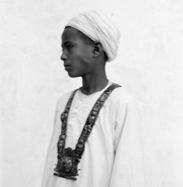1928_12_year_old_hussein_hassan_abdel_rassuh_wearing_tutankhamun_scarab_necklace_he_was_given_it_as_a_gift_from_howard_carter_as_a_thanks_for_discovering_the_staircase_leading_to_the_tomb.jpg