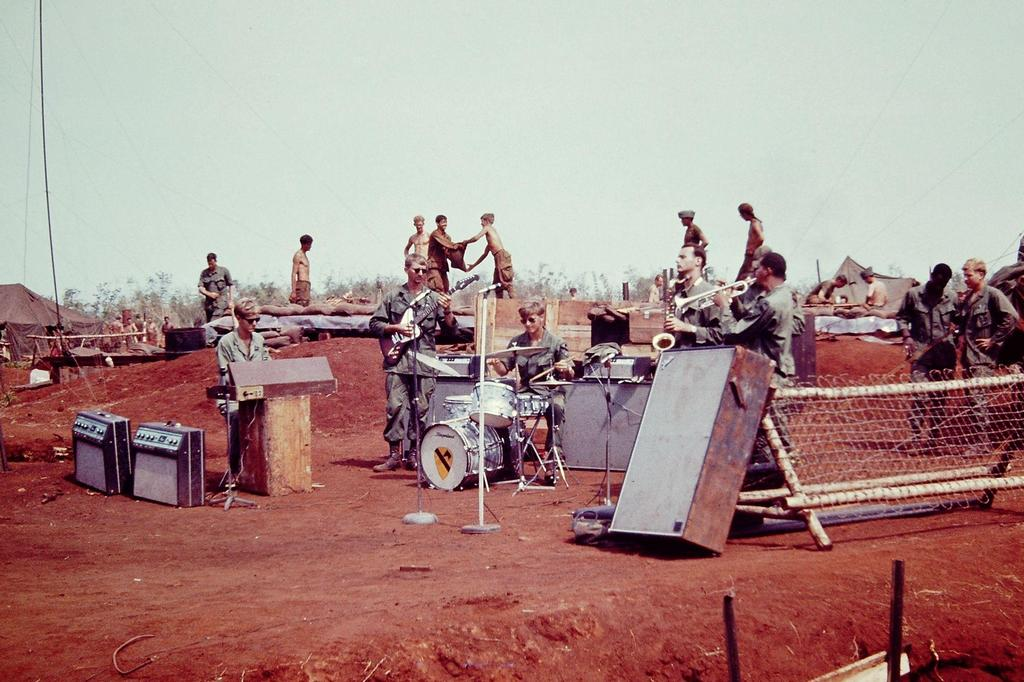 1969_a_group_of_soldiers_create_a_band_and_put_on_a_show_at_their_base_camp_in_cambodia.jpg