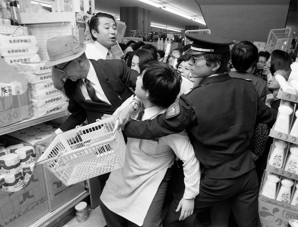 1973_frenzied_shoppers_afraid_that_paper_factories_would_grind_to_a_halt_during_the_oil_crisis_scramble_to_buy_toilet_paper_at_a_supermarket_in_tokyo.jpg