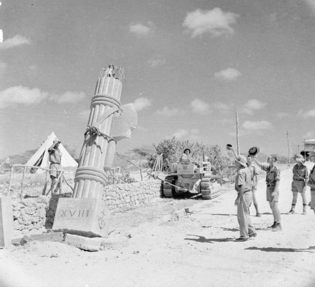 1941_british_troops_use_a_bulldozer_to_pull_down_a_fascist_stone_monument_at_kismayu_in_italian_somaliland.jpg