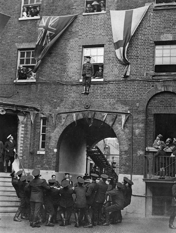 1922_a_fireman_jumping_from_a_window_into_a_safety_blanket_at_southwark_bridge_road_in_london.jpg
