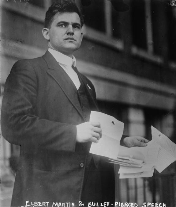 1912_president_theodore_roosevelt_s_secretary_elbert_martin_holding_pages_from_the_president_s_bullet-pierced_speech.jpg