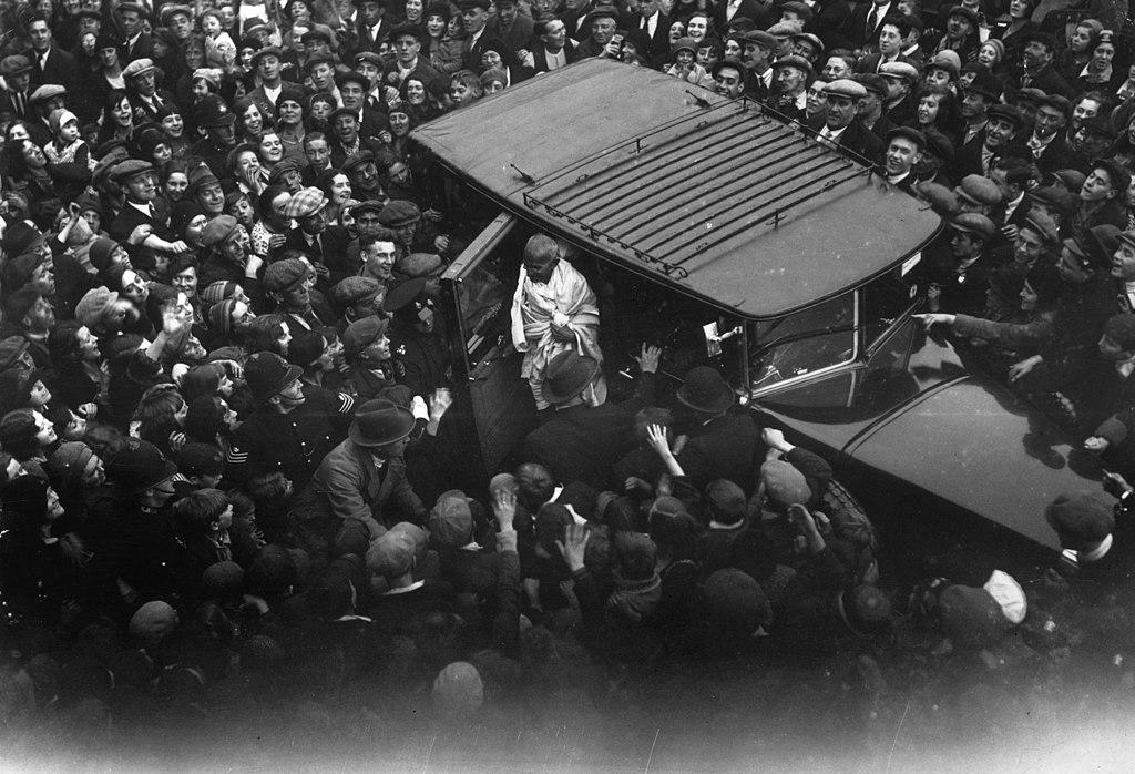 1931_a_crowd_gathers_to_witness_the_arrival_of_mahatma_gandhi_in_canning_town_east_london.jpg