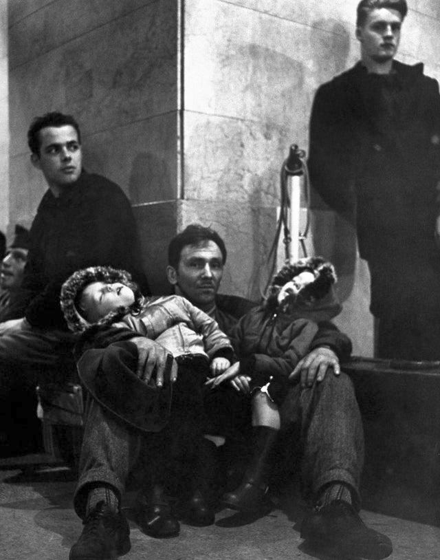 1947_on_the_floor_of_grand_central_station_a_father_and_his_two_young_sons_wait_through_the_night_for_the_train_home_during_the_great_blizzard_of_1947.jpg