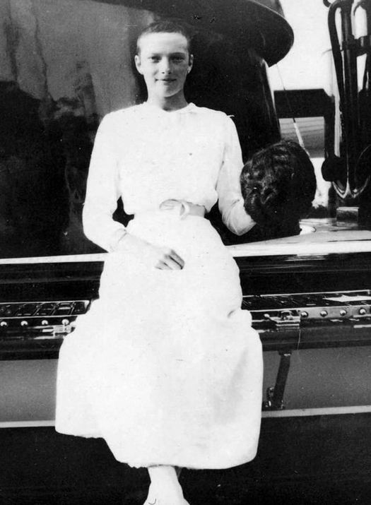1913_grand_duchess_tatiana_romanova_holding_her_wig_she_had_her_head_shaved_due_to_typhoid_causing_her_hair_to_fall_out.jpg