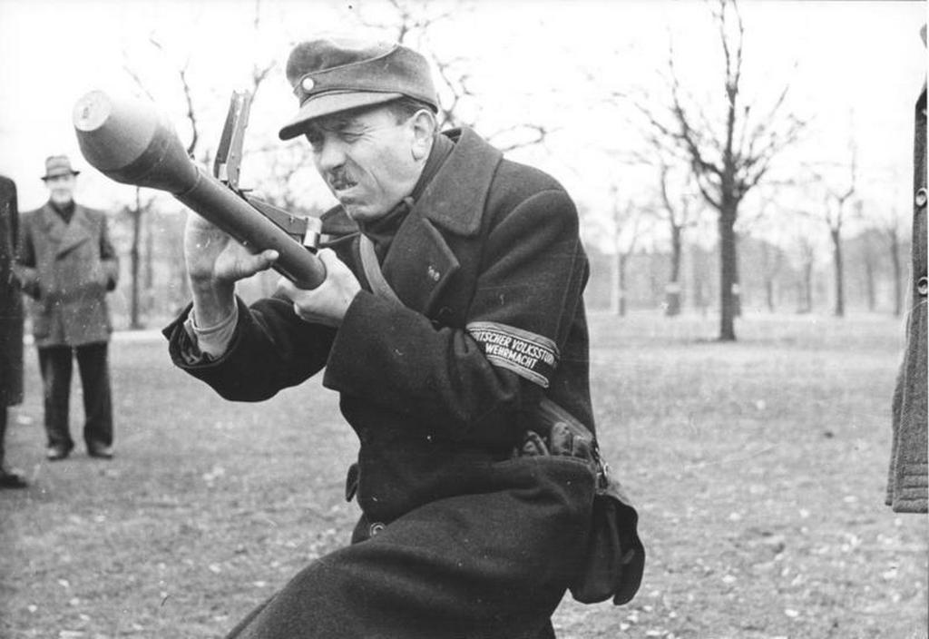 1945_marcius_an_elderly_member_of_the_volkssturm_aims_a_panzerfaust_rocket_launcher_during_training.jpg