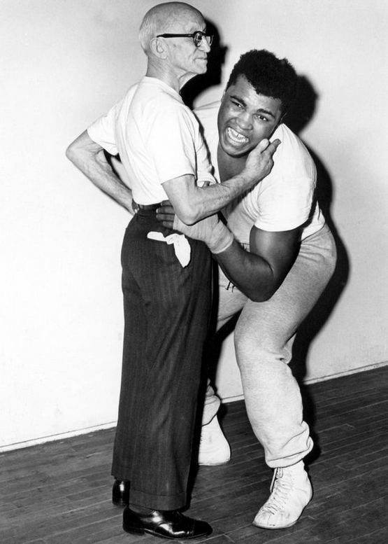 1965_muhammad_ali_attempting_to_lift_76_year_old_former_world_bantamweight_boxing_champion_johnny_coulon.jpg