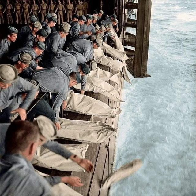 1944_the_surviving_members_of_uss_intrepid_s_crew_gather_to_pay_their_respects_to_69_men_killed_by_kamikaze_attacks_the_day_before.jpg