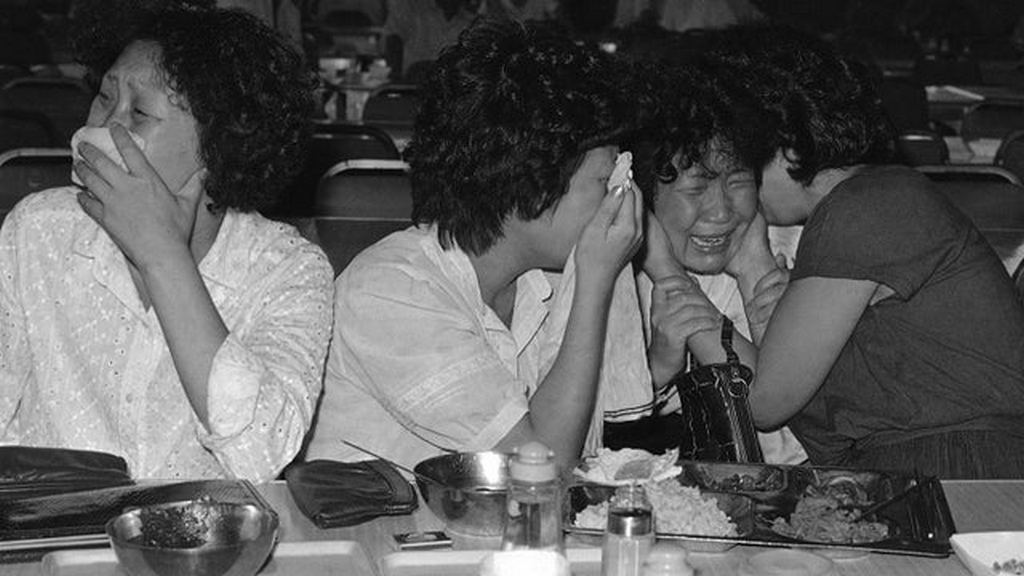 1983_family_of_a_passenger_onboard_korean_air_lines_flight_007_mourning_after_hearing_the_news_that_the_plane_was_shot_down_over_soviet_airspace_on_september_1st_with_no_survivors_among_its_269.jpg