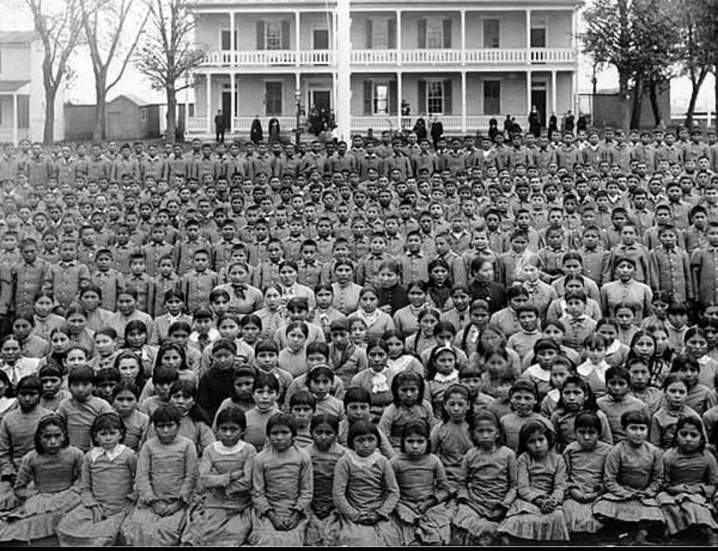 1900_this_is_a_photo_of_the_students_at_carlisle_indian_industrial_school_in_pennsylvania.png