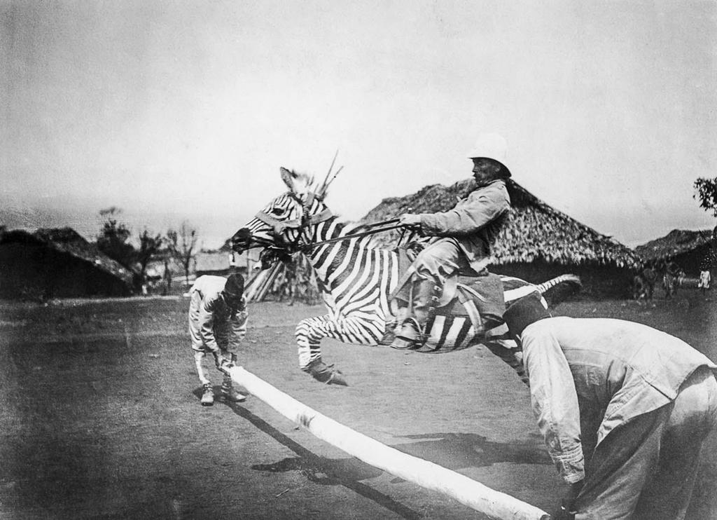 1910_a_german_colonial_officer_takes_a_leap_on_the_back_of_a_tamed_zebra_in_east_africa.jpg