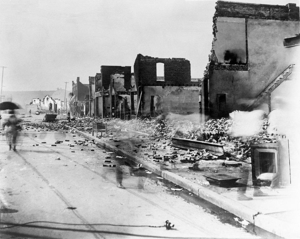 1921_aftermath_corner_of_greenwood_avenue_and_east_archer_street_of_the_tulsa_race_massacre.jpg