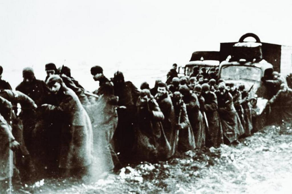 1941_german_troops_and_local_peasants_hauling_military_vehicles_across_a_river_bank_near_moscow.jpg