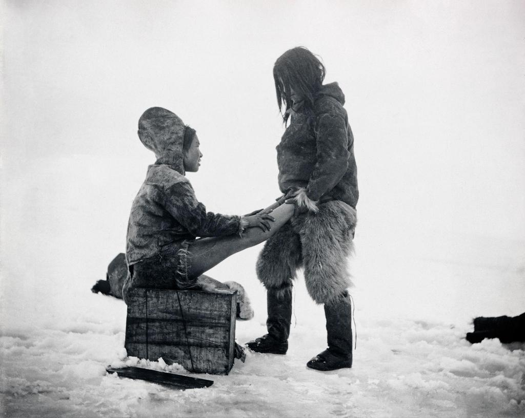 1898_an_inuit_man_warms_up_his_wife_s_feet_in_greenland.jpg