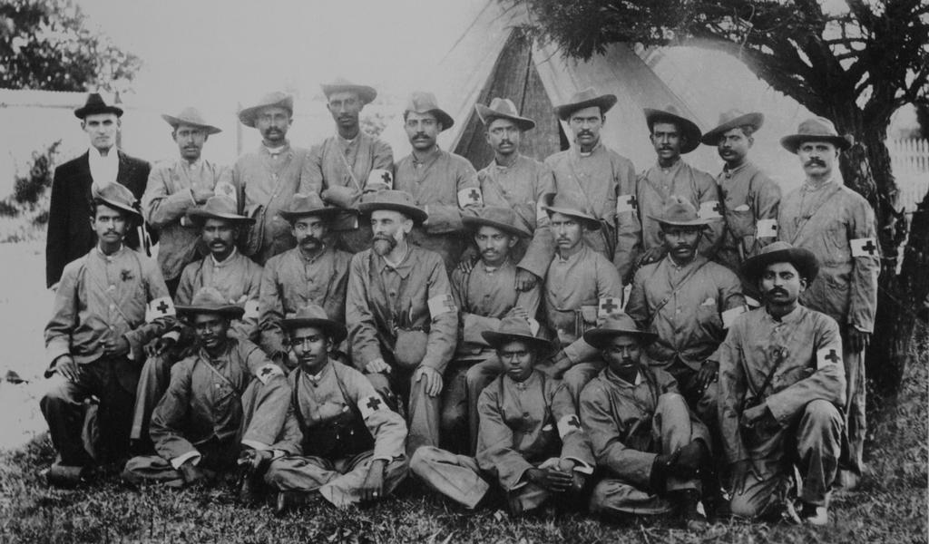 1900_gandhi_middle_row_fifth_from_the_left_end_in_the_natal_indian_ambulance_corp_during_the_second_boer_war.jpg