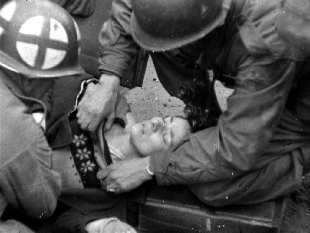 1945_marcius_u_s_army_medical_personnel_examining_a_mortally_wounded_german_civilian_in_cologne.png