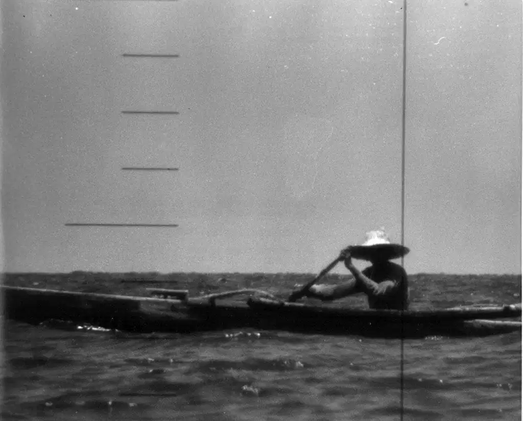 1960_filipino_fisherman_rufino_baring_staring_into_the_periscope_of_uss_triton_who_was_on_a_top-secret_mission_to_do_the_first_submerged_circumnavigation_of_the_world.png