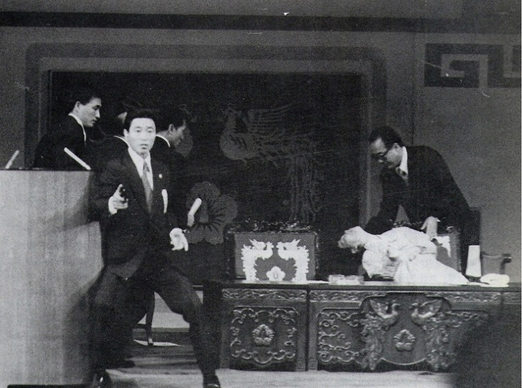 1974_first_lady_of_south_korea_yuk_young-soo_slumps_down_after_shot_by_a_nkorean_sympathiser_an_assasination_attempt_on_president_of_skorea_park_chung-hee_on_k_indep_day_ceremony_at_the_n_theater_seoul.jpg