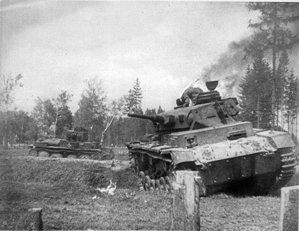 1941_german_soldier_is_on_fire_as_he_attempts_to_escape_his_burning_tank_eastern_front.jpg
