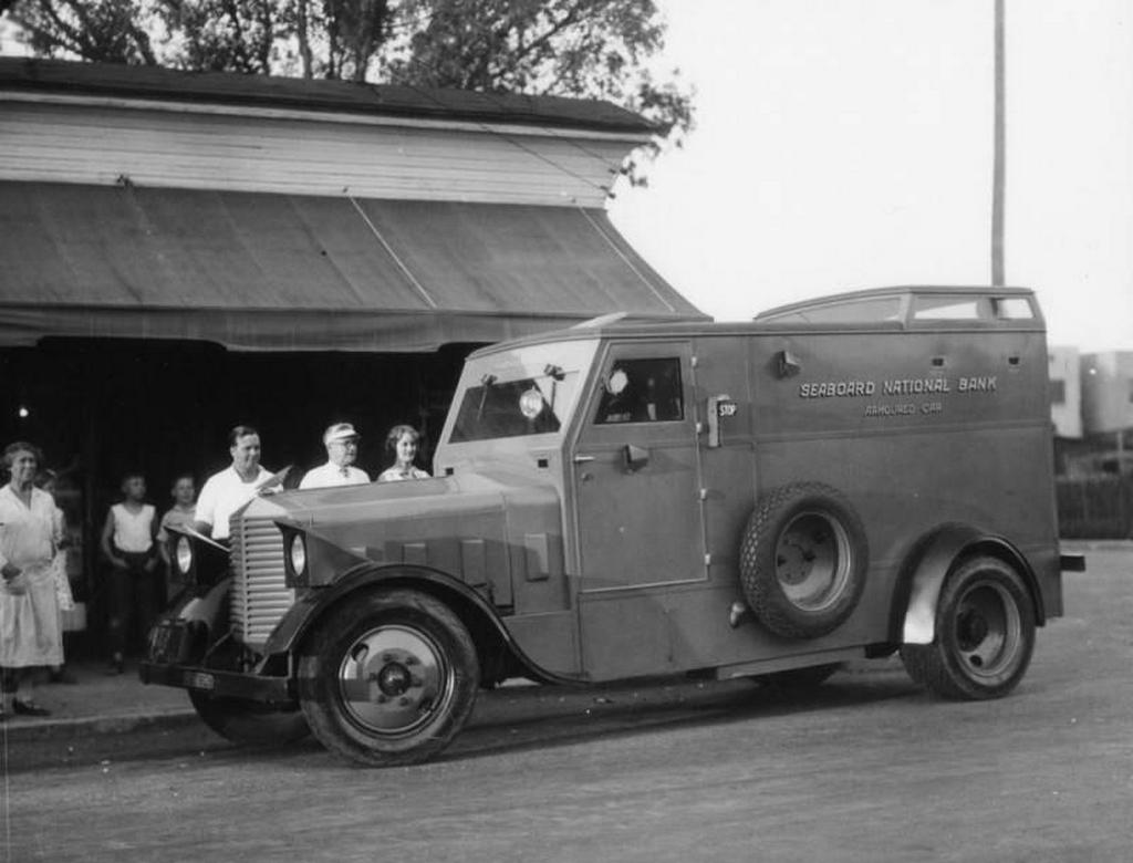 1929_los_angeles_ca_street_corner_customers_do_their_banking_with_a_roving_teller_who_sits_inside_a_seaboard_national_bank_armored_car.jpg