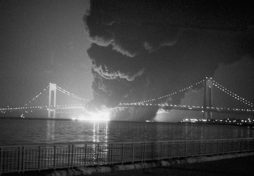 1973_smoke_rises_from_a_collision_between_the_u_s_container_ship_sea_witch_and_the_esso_brussels_in_new_york_harbor_near_the_verrazano_bridge_in_new_york.jpeg