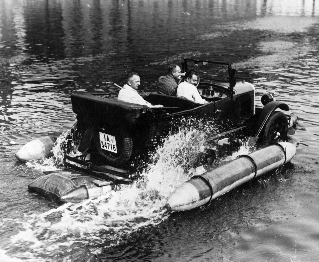 1930_a_motor_car_equipped_with_floats_making_its_way_along_the_river_spree_in_berlin_germany.jpeg