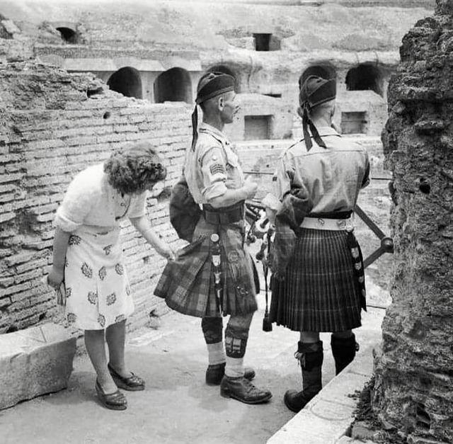 1944_an_itallion_woman_inspects_a_scottish_soldiers_kilt_coliseum_rome.jpg